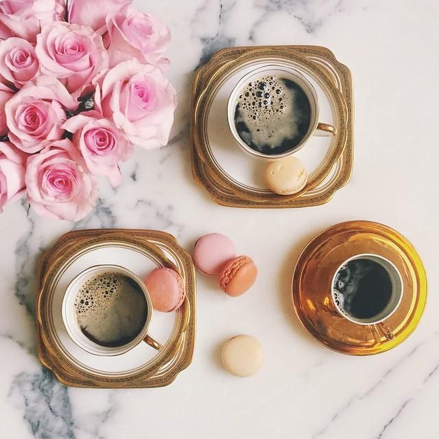 gold rimmed saucers and cups filled with coffee #macarons #marble #roses