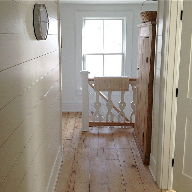 Sunny Sunday morning - love that the light reflects off the glossy painted planked walls in the upstairs hallway.  Painted China white by Benjamin Moore. #farmhousestyle #nautical #simplicity #minimal #whiteandwood #natural