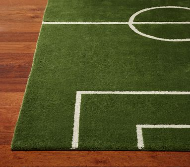 Soccer Rug on potterybarnkids.com could also get a green rug & create lines with paint & create a DIY