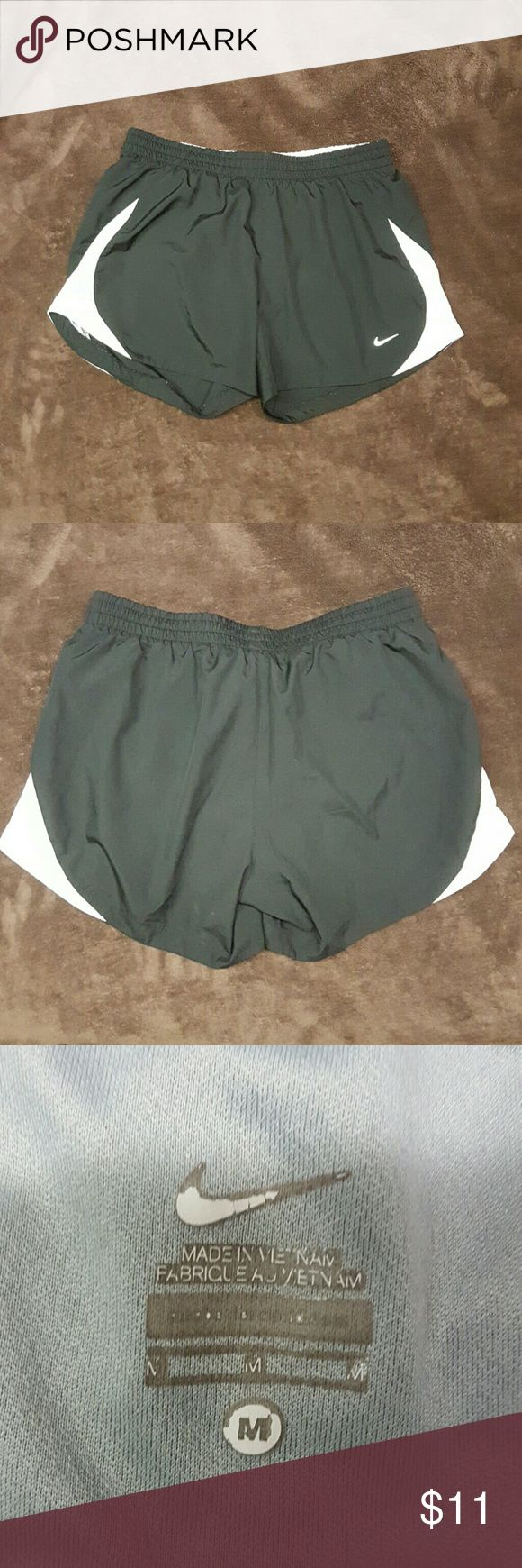 Nike running short with built in underlayer Gently used.  Built in underwear layer. Interior is silver. Nike Shorts
