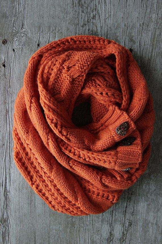 COLOR + STYLE A Best Seller! Custom dyed yarn for the perfect pumpkin colored scarf!  DETAILS .cable knit scarf with three leaf buttons. .100% acrylic yarn .custom colored acrylic yarn/cable knit fabric .55in L x 15in W (may vary) .picture shows a double loop .hand-wash, line dry by cozy fire .color may vary depending on your computer screen