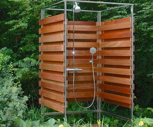 Crafted of sustainable wood, this architectural, elegant shower can be sized for one or more bathers. A seating area/changing space can be appended on to the core structure.