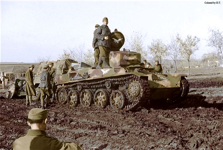 Toldi tank pulls a lorry out of the mud. The later symbol of light tank squadron of 1.cavalry brigade,the Turul bird.