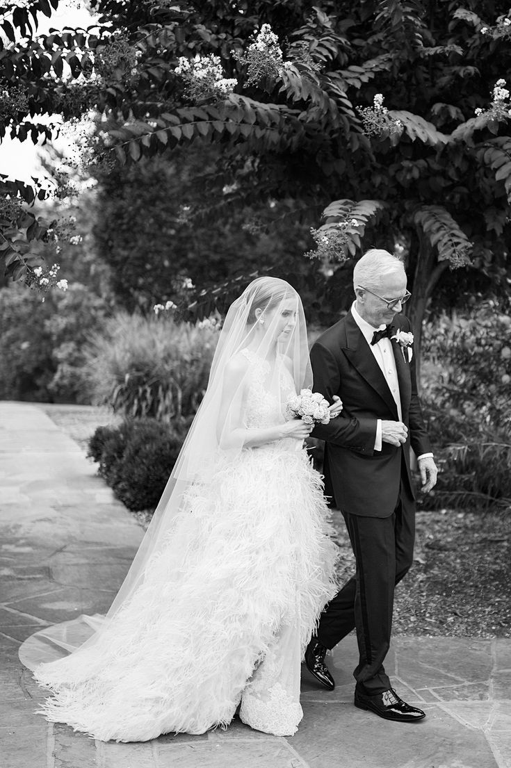 """The decision to put the veil over my face was totally last minute. It was my dad's idea. After reminding me that Grace Kelly wore her veil the same way, my friend Jennifer Battistello said, """"Annie, you're getting married and you just have to own it."""" As my dad walked me down the aisle he started telling me how much he and my mom love me, and I almost broke down in tears."""