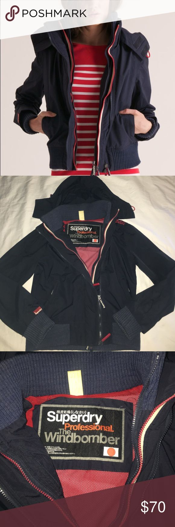 Superdry The Windbomber Hooded Jacket Great condition! Navy Blue and Red. Says size Large but fits a Medium better! Very snug Superdry Jackets & Coats