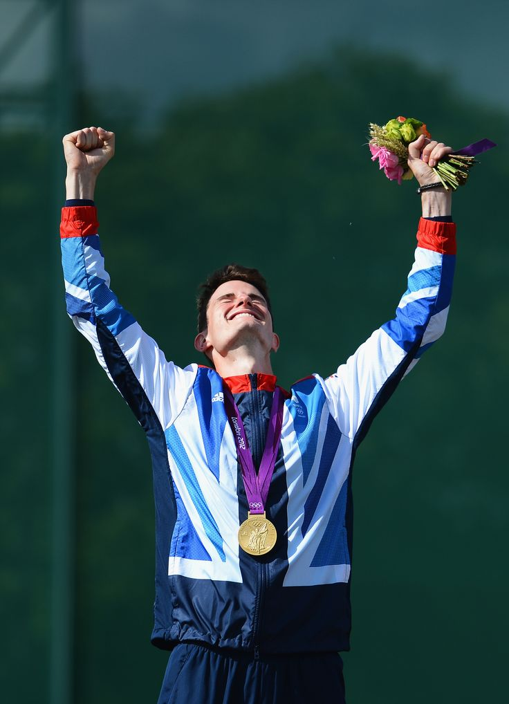 Peter Wilson celebrating on the podium after winning gold in shooting at London 2012