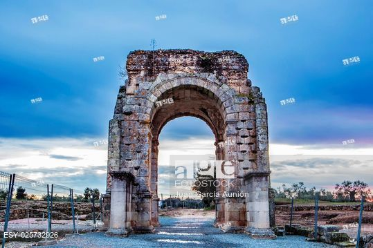 Stock Photo: Roman Arch of Caparra at dusk, (1st-2nd century AD). Crossroad ancient city ruins at Silver Route, Via de la Plata, Caceres, Spain.