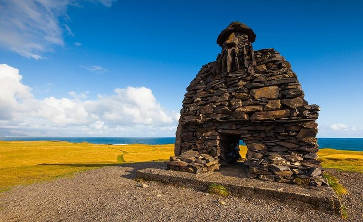 The huge stone structure of Bardur Snaefellsnes at Arnarstapi on the Snaefellsnes peninsula in West Iceland. #Bardur #Snaefellsnes #Iceland #Arnarstapi #monument #travel #tour #explore #bucketlist #adventure #photography #vacation