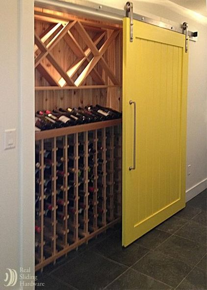 """I love sliding barn doors! What a great idea to have a """"wine closet/cellar"""" behind one!"""