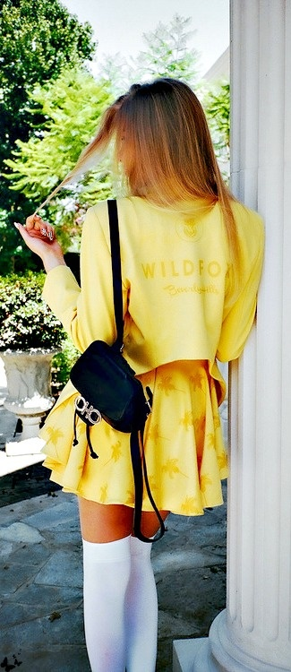Channel 90's Clueless with vibrant yellow hues and a micro rucksack