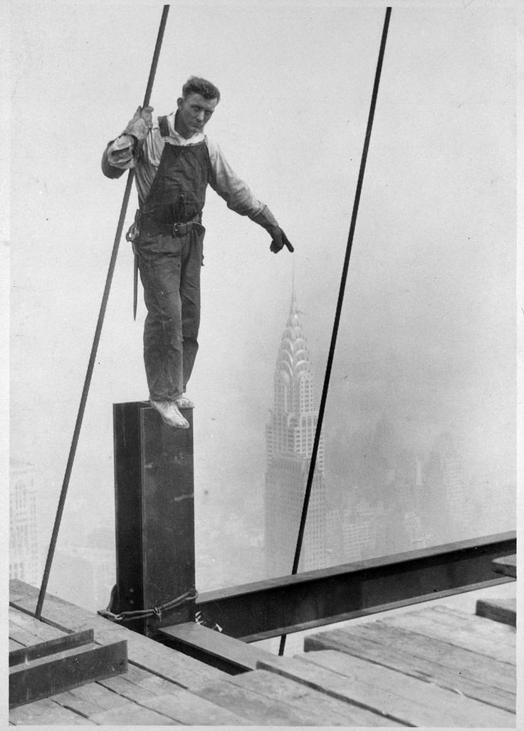 empire state building construction worker touching the top of the chrysler building - lewis hine, 1930 [gelatin silver print]