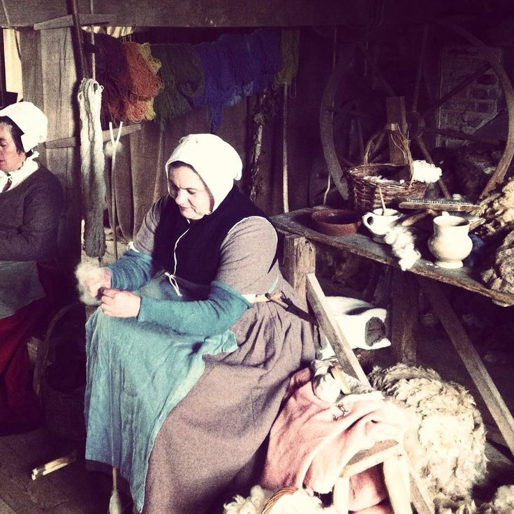Spinners preparing wool from the Kentwell flock of Norfolk Horn sheep. Tudor High Summer
