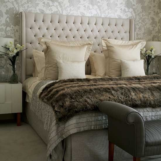 Neutral color palette & full of texture.  A more formal bedroom.