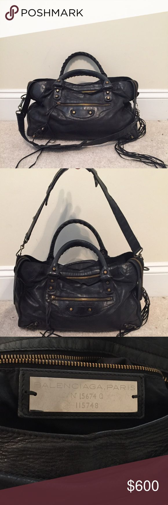 Balenciaga Handbag Black Balenciaga city handbag with gold colored hardware and tassels. All zippers work. Comes with shoulder strap (pictured), no dust bag. Leather is broken in, was kept routinely conditioned by a cobbler. Feel free to message w questions! Balenciaga Bags Shoulder Bags
