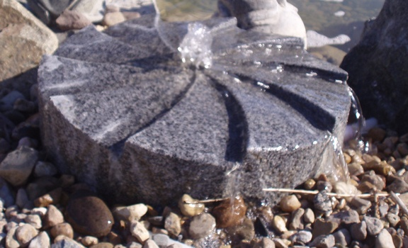Hand-carved from natural stone, this Charcoal Grey Granite bubbling fountain by Carved Stone Creations features a spiraling grooved design which channels the bubbling water out from the center in a very unique way. $100 Click on the image to see it in our online store.