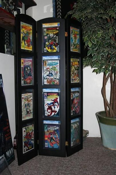 Comic book Tri-fold Display. I kinda love this idea for vintage magazine display or vintage records or book pages!