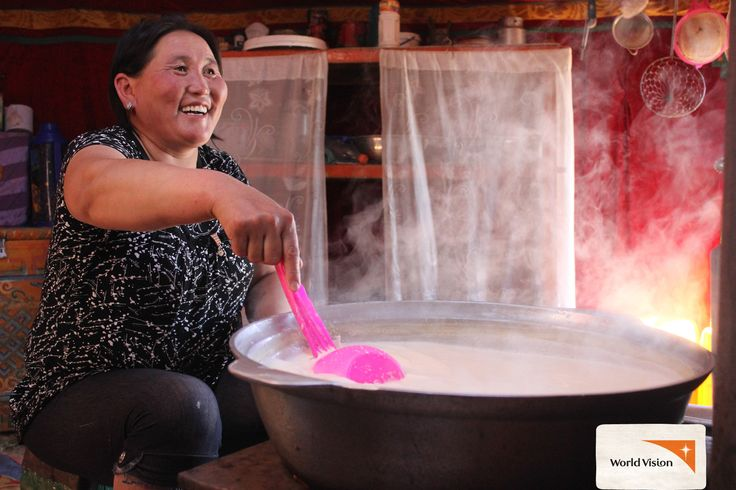 """I am making dried #yoghurt and I'm going to sell it, and we will eat it as well!"" says Baasanjav, wife and mother of two. #Dairy products are something of a staple in the #Mongolian diet, and the family's income relies upon it. Photo by Natasha Cheung, #WorldVision"