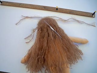 "A tut by Sarah's Dolls - ""I've been using this homemade tool, made by my husband, for the past few years. It makes the hair strands all the same length in layers, and saves lots of time. The hair layering tool is 22"" in length, the pegs and 21"" and 8"" apart, and these 3 pegs can make 5 different hair lengths."""