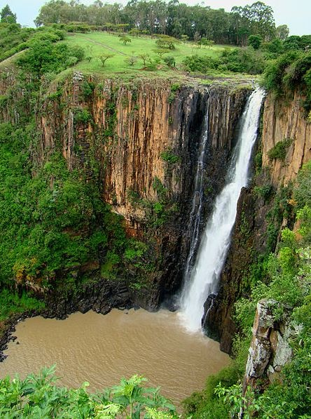 """Howick Falls is a waterfall in Howick  KwaZulu-Natal South Africa - the waterfall is approximately 95 metres in height and lies on the Umgeni River - the Zulu people call the falls KwaNogqaza which means """"Place of the Tall One"""" - in local legend the inKanyamba, a giant serpent-like creature lives in the pool at the bottom of the falls..."""
