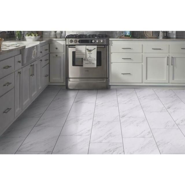 Brand New Trafficmaster Carrara Marble 12 X 24 Peel Stick Vinyl Tile Ebay Vinyl Tile Marble Tile Floor Marble Vinyl