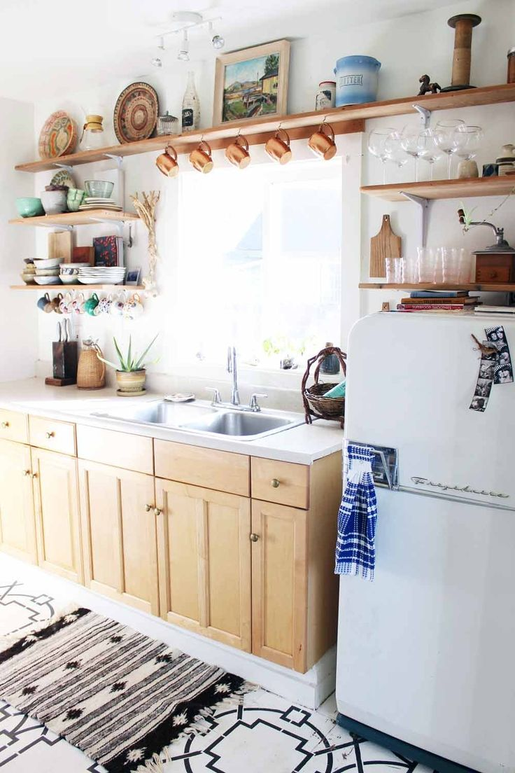 In keeping with the original Cape Cod style of her 1,400-square-foot Portland, OR bungalow, Anna Harris set out to complete a hands-on, $700 kitchen makeover. As the digital shopkeeper behindExperimental Vintagewhere she sells vintage furniture, housewares, textiles, and art, Anna wanted her small galley kitchen to remain functional for cooking as well as a place to showcase the special antiques she hunts and gathers. 'I love the idea of bringing home something used instead of new for…