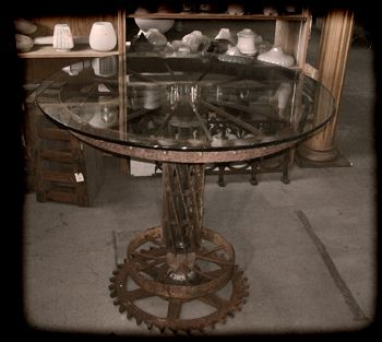 Tractor steel wheel cafe table - Caravati's Inc.