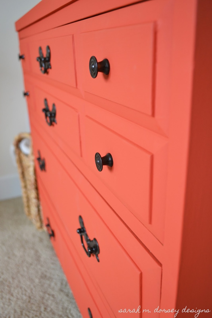 Coral colored chalk paint dresser