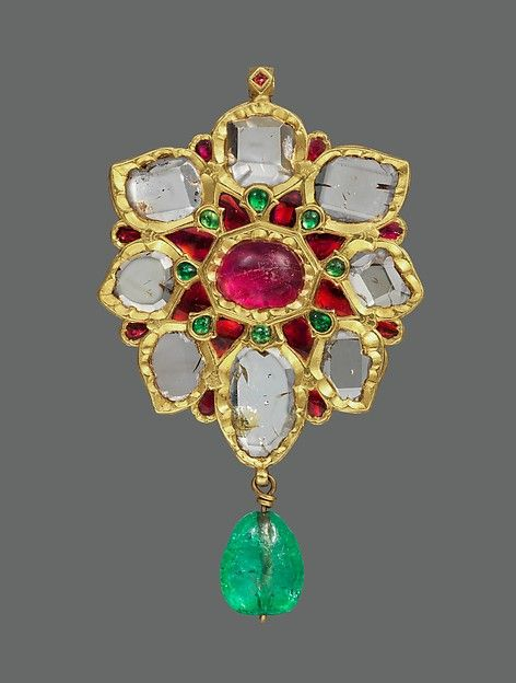 Floral Pendant with Upswept Petals. Floral Pendant with Upswept Petals (first half 17th century, Islamic) Fabricated from gold; worked in kundan technique and set with diamonds, rubies and emeralds; with pendant emerald bead.