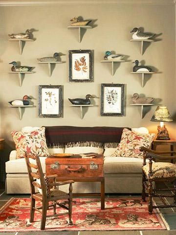Duck decoys and framed leaf prints fill the wall with earthy decor in this nature-inspired room.