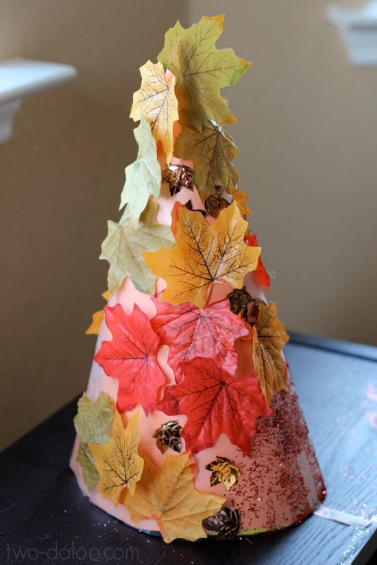 Create fall trees with repositionable leaves- a perfect way to introduce the…