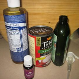 Homemade natural shampoo and conditioner in one: castille soap and coconut milk, plus essential oil for scent, in an old shampoo bottle