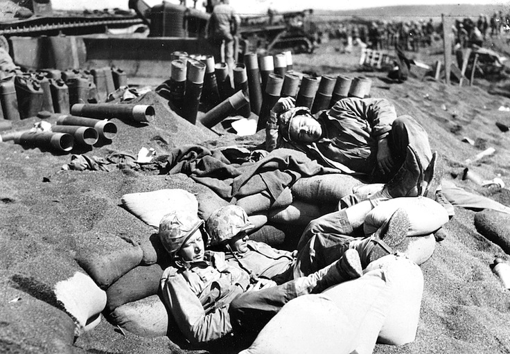 Iwo Jima: Three Marines doze off surrounded by empty shells and heavy caterpillars on the volcanic sands of Iwo Jima. Iwo Jima (19 Feb - 26 March 1945) was the only battle by the U.S. Marine Corps in which the overall American casualties (killed and wounded) exceeded those of the Japanese, although Japanese combat deaths were thrice those of the Americans throughout the battle. Of the 22,000 Japanese soldiers on Iwo Jima at the beginning of the battle, only 216 were taken prisoner.