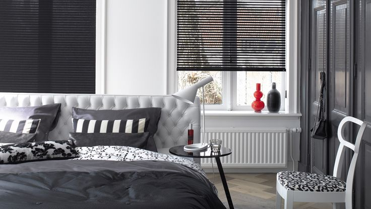 Choose the perfect balance between privacy and light at any moment of the day. An endless chain allows you to slide the transparent and opaque woven sections past each other to open partially open or fully close our Facette® Shades.  #black #bedroom #home decor #luxaflex #Facette® Shades.