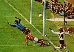 West Germany 1 Chile 0 in 1974 in Berlin. Uli Hoeness plays a dangerous ball into the Chile danger zone in Group 1 at the World Cup Finals.