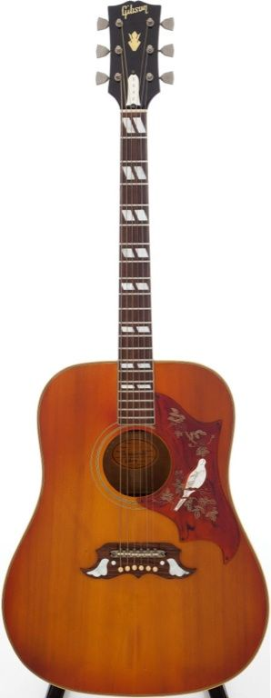1960's Gibson Dove acoustic.. Beautiful....and expensive.