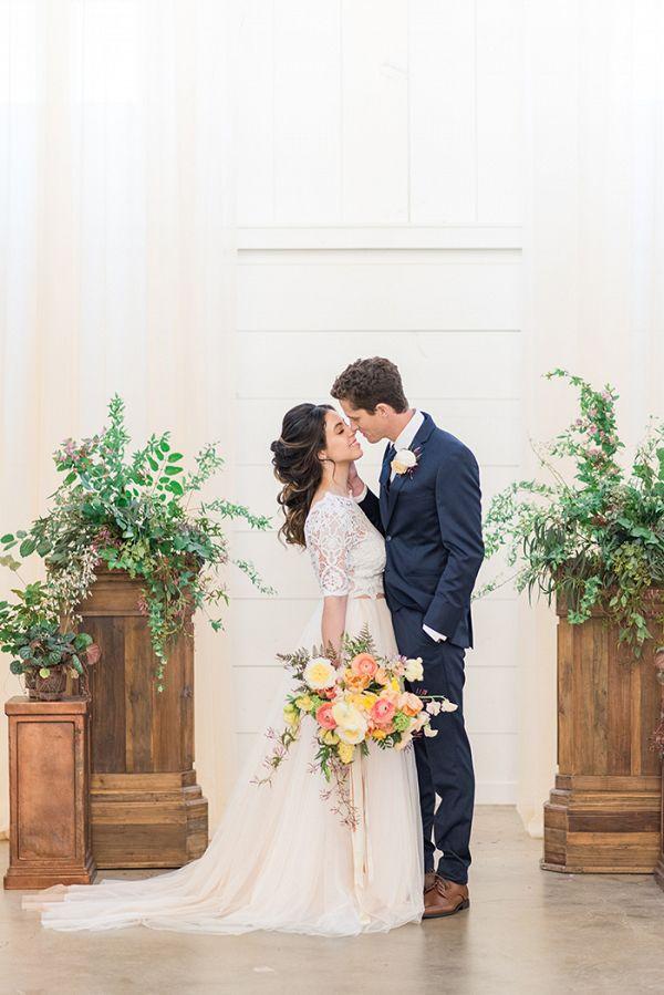 Summer Barn Wedding Ceremony with Greenery