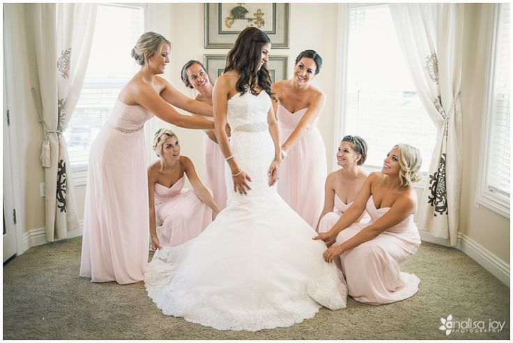 Wedding: Kyle & Rachel // Wilson Creek Winery, Temecula, CA» Analisa Joy Photography // bridesmaids helping the bride get into her dress