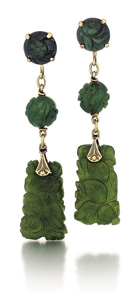 Antique Carved Jade Lady's Drop Earrings, Pair. Two carved tapered jade drops in floral and leaf design. Two carved jade spheres at center and two carved jade buttons at top of each. Yellow gold screw backs.