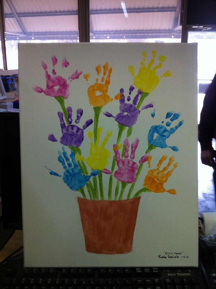 Flowers- canvas hand print - I love handprints!  This is precious!