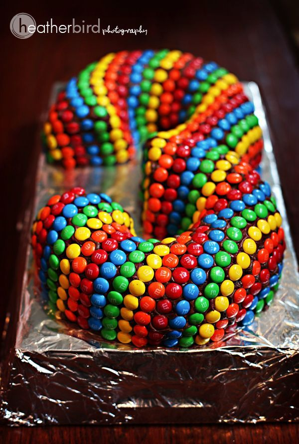 """""""Three"""" 3 cake using two bundt cakes and lots of m&ms!"""