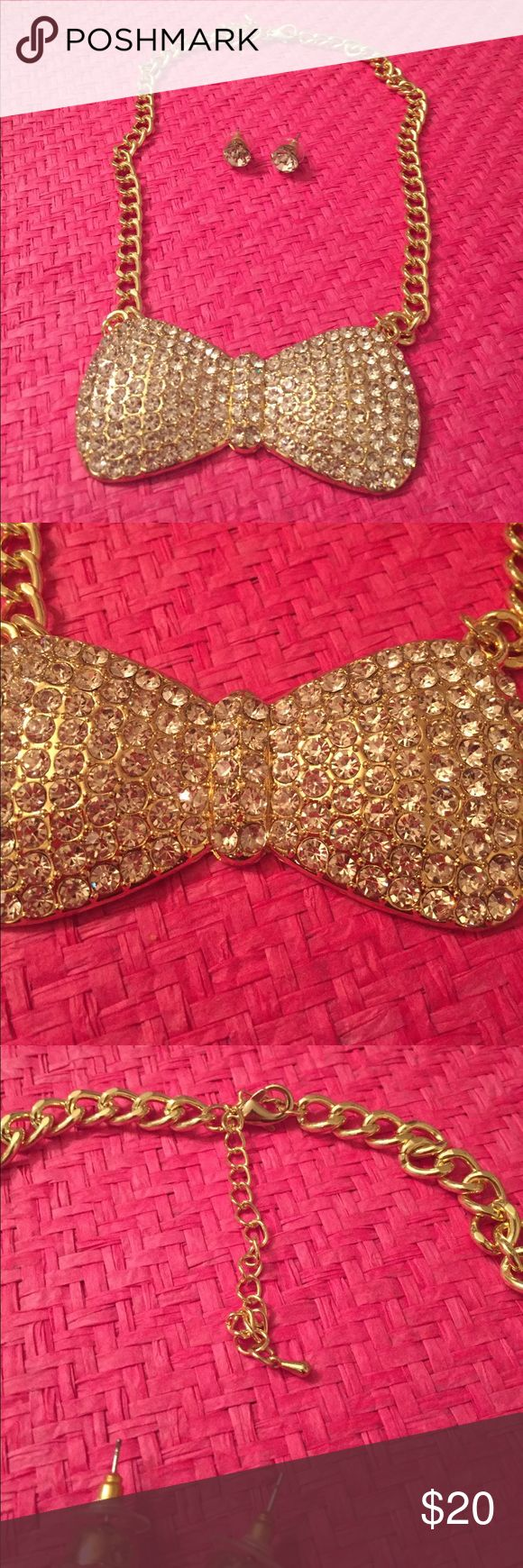 Rhinestone Bow Tie Necklace Set Beautiful gold and crystal rhinestones bow tie and earrings set. Earrings are for pierced ears.  Standard chain closure with extension chain. In excellent condition. Ghs Jewelry Jewelry Necklaces