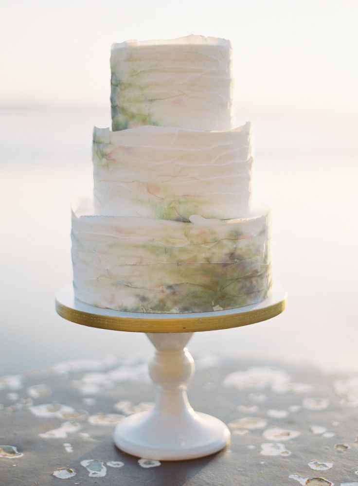 Cake: Smudged watercolor effect, coastal wedding - http://www.stylemepretty.com/portfolio/knead-to-make Photography: Brett Heidebrecht Photography - http://www.stylemepretty.com/portfolio/brett-heidebrecht-photography   Read More on SMP: http://www.stylemepretty.com/2014/09/01/coastal-california-wedding-inspiration/