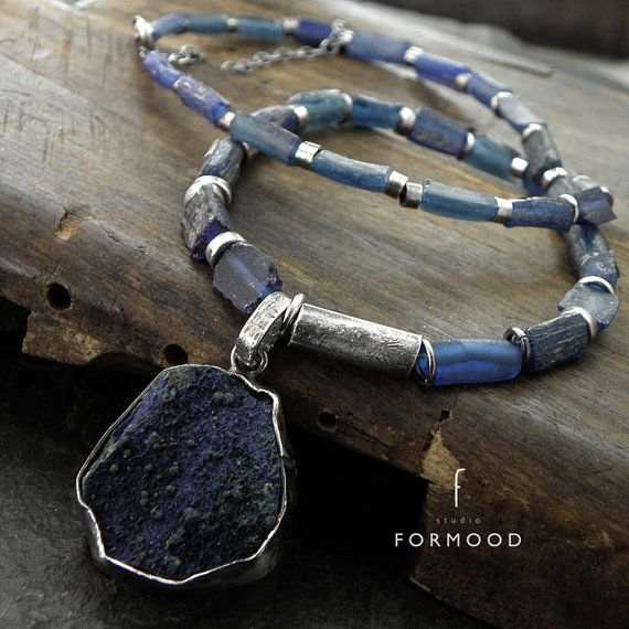 Necklace is made of oxidized sterling silver 925, ancient glass and Lazurite  Dimensions: Total length: 43cm (16.9 inches) Stones: 3-25 mm (0.12-0.98 inches)  Ready to ship  We pack all the items in corporate boxes (visible in some offers). We ship all the consignments as priority registered consignments in well protected cartons.  Thank you for visiting