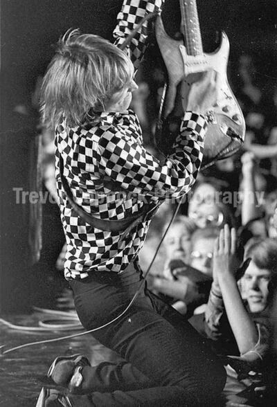 Tom Petty rockin out in a checkered jacket