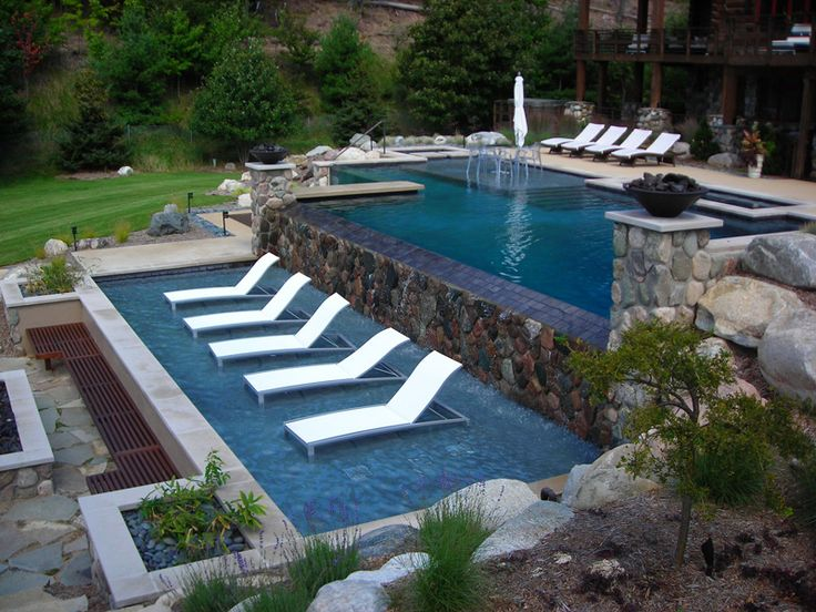 Creating outdoor spaces with multiple rooms.  We design your outdoors like the indoors!  apexlandscapemi.com