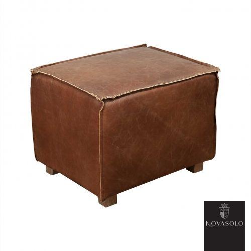 Tøff Buxton puff i vintage leather.