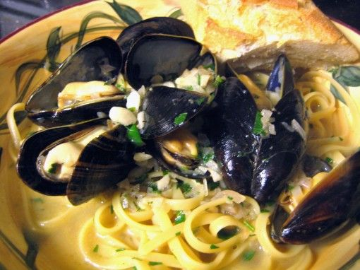 Steamed Mussels in Garlic White Wine Sauce - very tasty, but I used the Costco frozen seafood medley and added a lot of oregano and basil and chicken stock as well