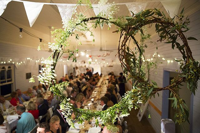 Eureka Hall was decorated with bunting created by Bunting By Design, as well as suspended wreaths of vine, silvergum and Queen Anne lace, and pink blossom hanging from the beams.
