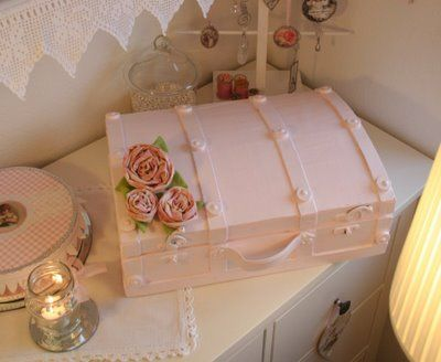 Old brown trunk painted pink with fabric roses