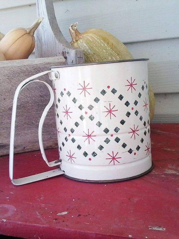 Check out this item in my Etsy shop https://www.etsy.com/listing/114428934/rustic-sifter-vintage-red-black-flour